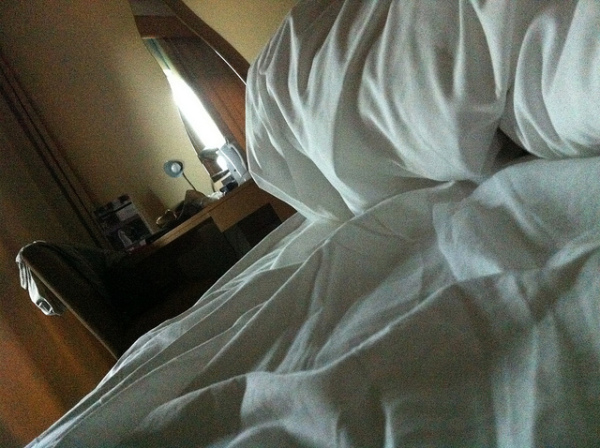 Hotel bed || creative commons photo by Sean MacEntee