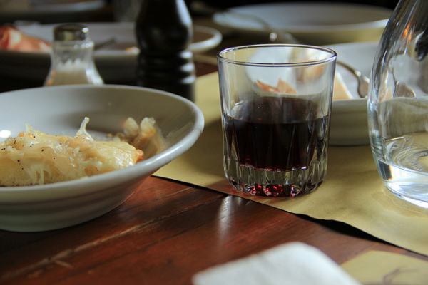 Wine at an agriturismo meal || creative commons photo by Michela Simoncini