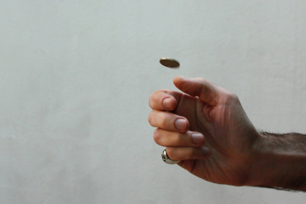Flipping a coin || creative commons photo by Nicu Buculel