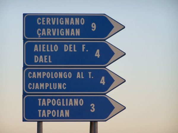 Highway sign in Italian & Friulano || creative commons photo by Klenje