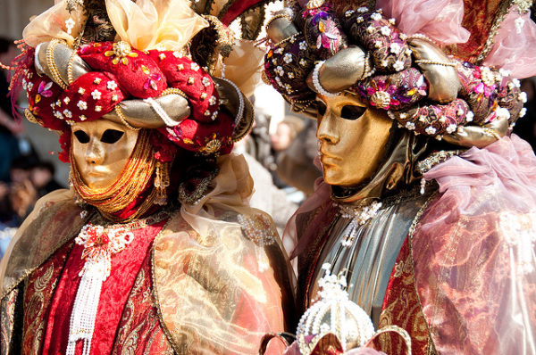 Carnevale revelers in Venice || creative commons photo by Giorgio Minguzzi