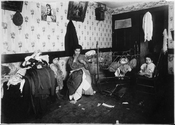 Italian immigrant in New York City working in her home, circa 1912 (US National Archives)