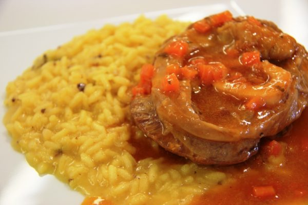 Ossobuco with risotto alla Milanese || creative commons photo by Javier Lastras