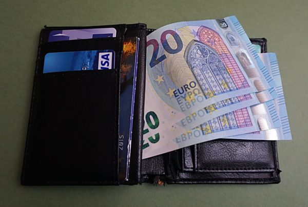 Euro notes in a wallet || public domain photo