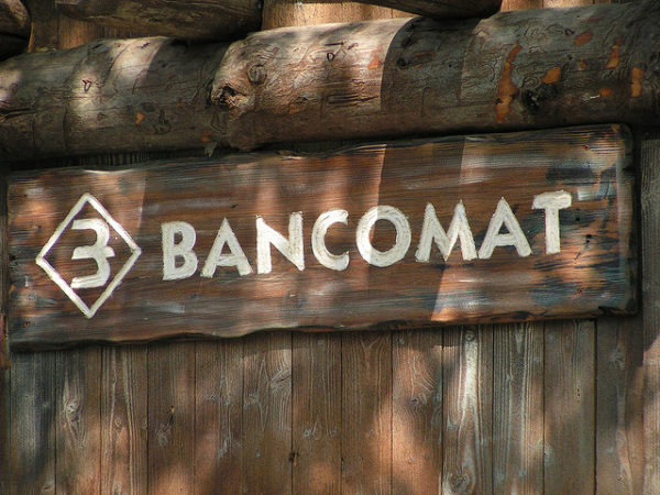 Bancomat sign in Gardaland || creative commons photo by Simone Ramella