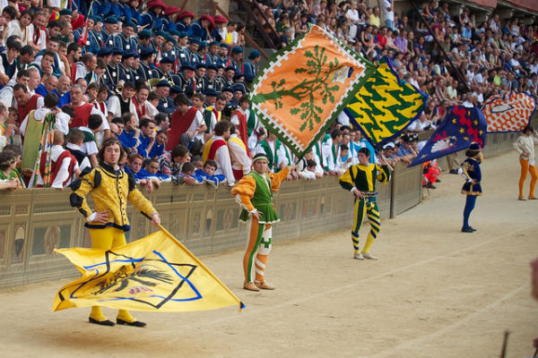 Siena Contrade flagbearers before the Palio || creative commons photo by Janus Kinase